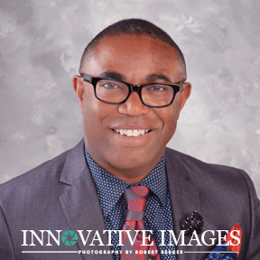 LinkedIn headshot portrait of man with glasses